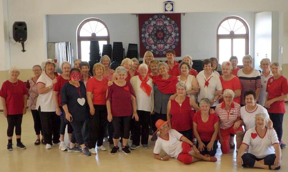 Gym Trim Ladies dressed in red