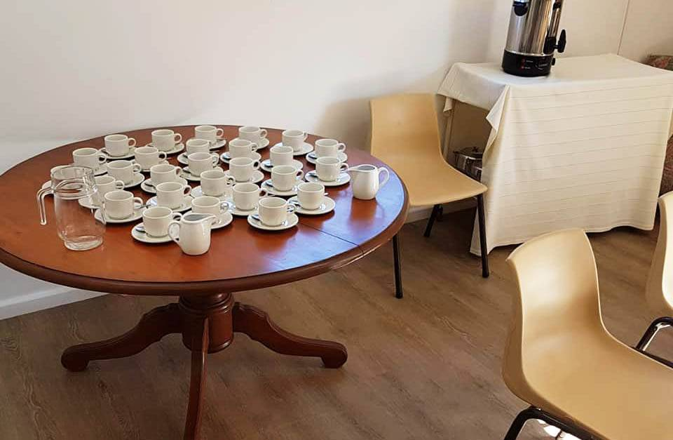 Cups and saucers set out for tea and coffee